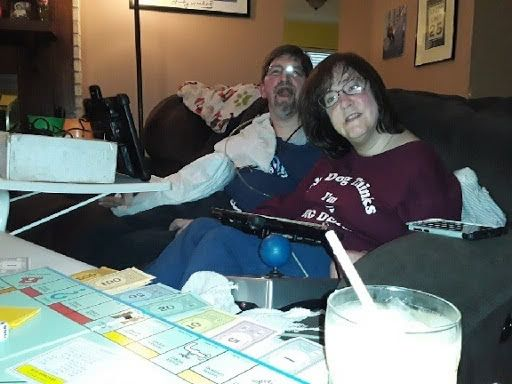Dave Chapple and his wife playing Monopoly at home