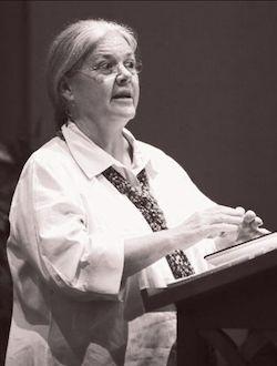 Sharron speaking at a podium