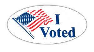 """A common """"I Voted"""" sticker with an American flag."""