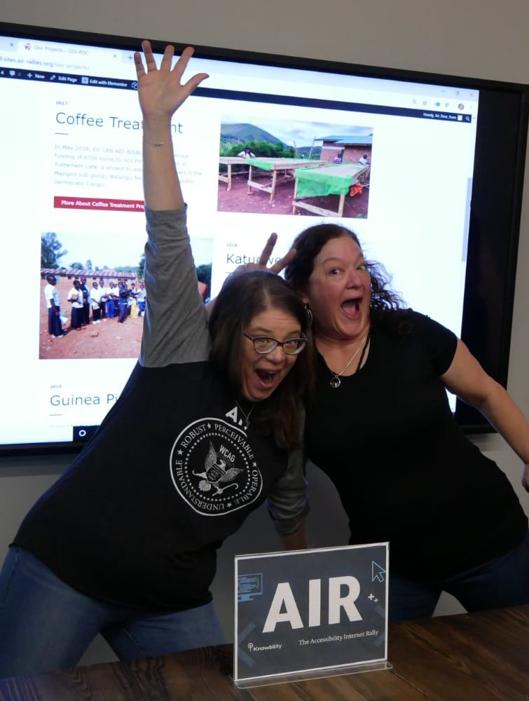 Two women celebrating at the AIR competition.