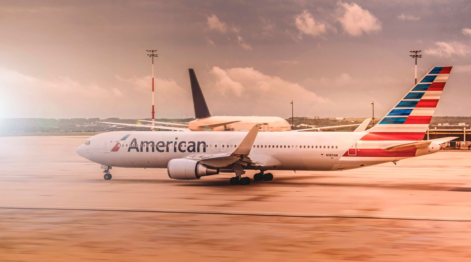 Image of a plane with an American Airlines logo sitting on a runway.