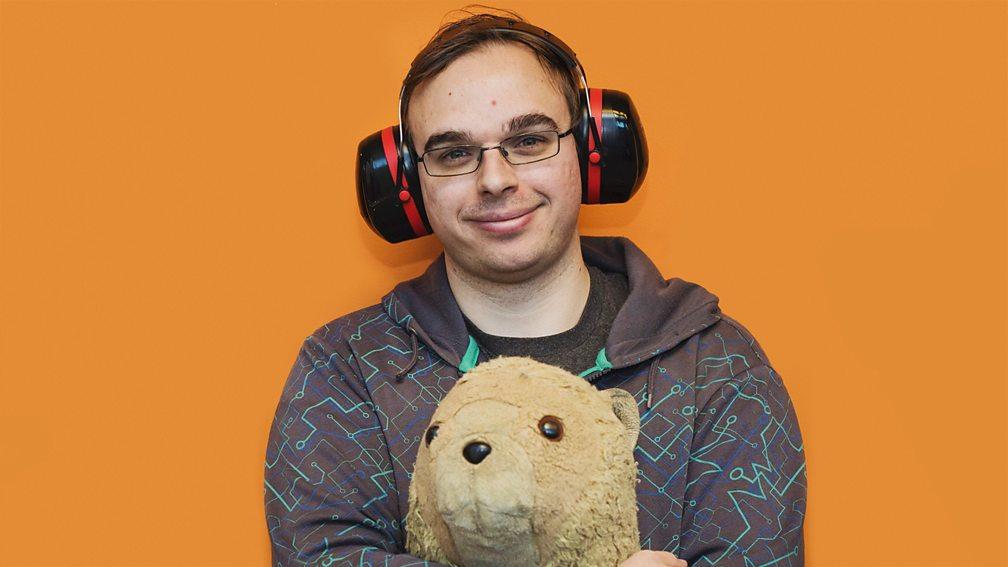 Jamie Knight, wearing earmuffs, holding Lion