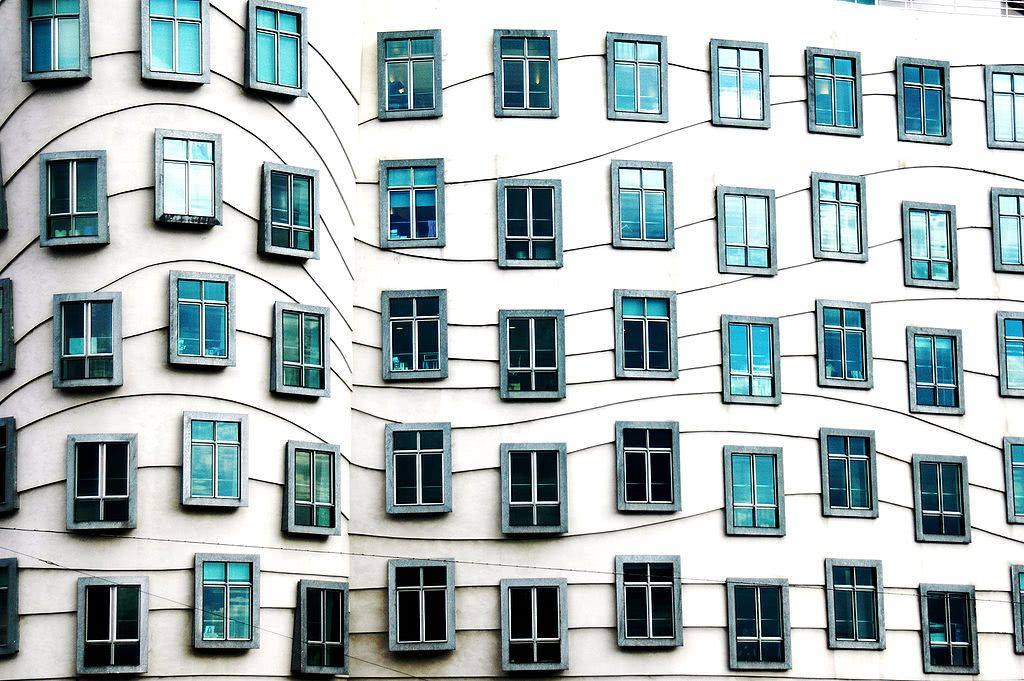 A building with many windows organized in wavy rows