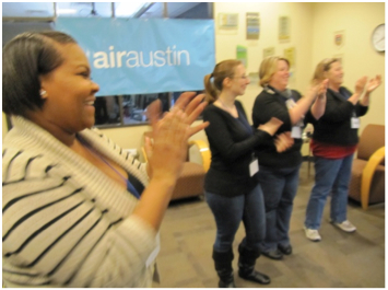 Participants of Air Austin applauding.