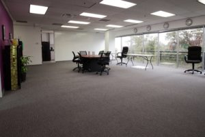 Knowbility meeting room with big windows.